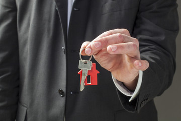 home key in an realtor estate agent