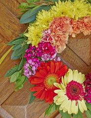colorful flowers wreath partial view closeup