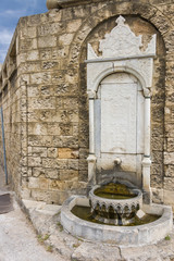 Medieval fountain with frescoes
