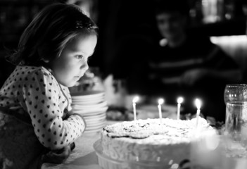 Little girl and birthday cake
