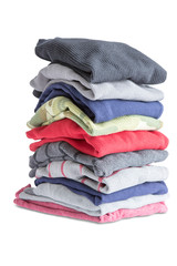 Folded Clean Clothes in a Pile on White Background