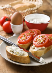breakfast - bread with tomatoes and cream cheese