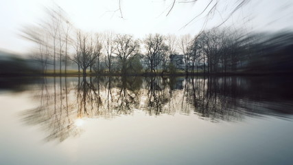 Lake at ostpark at sunny morning in frankfurt, germany. trees re