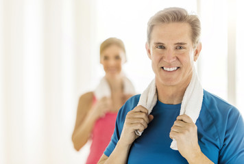 Fit Mature Woman Holding Towel Around Neck At Home
