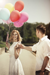 Love and wedding concept. Young attractive happy couple with col