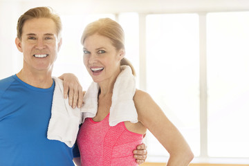Happy Mature Couple In Sports Clothing At Home