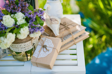 Picnic white table with beautiful bouquet