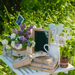 Picnic white table with beautiful bouquet  flowers