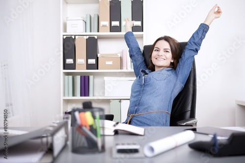 Office Woman Sitting on Chair Stretching her Arms - 80794850