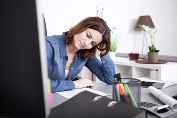 Attractive woman working hard at the office