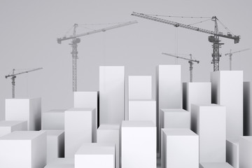 White cubes with wire-frame tower cranes. Cropped image