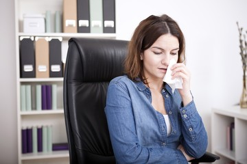 Distressed businesswoman sitting crying