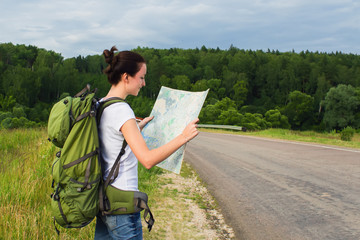 Woman hiker reading map