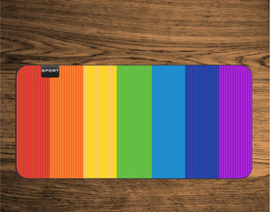 rainbow yoga mat on wood texture floor