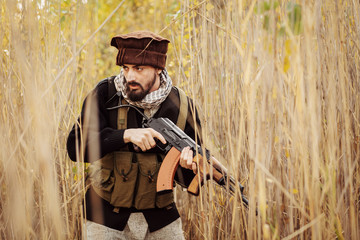 Portrait of serious middle eastern man with rifle