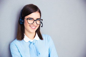 Smiling female operator with phone headset