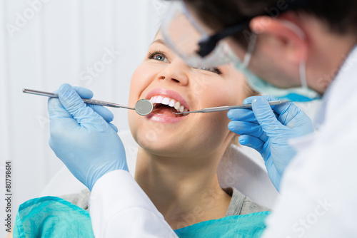 Leinwanddruck Bild Regular dentist visit. Caries cure. Young woman visiting dentist