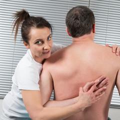 A man Receiving Shiatsu Treatment From a woman therapist
