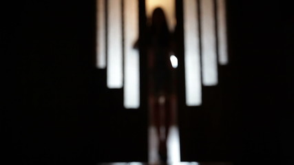 blurred silhouette of a girl in the room in doorway