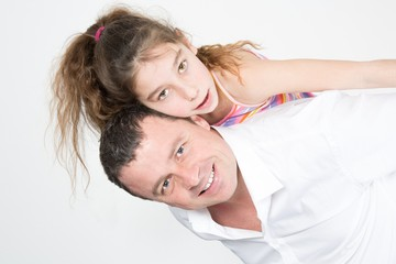 Father giving her daughter a piggy back ride