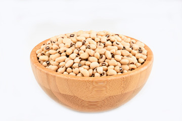 Bean in the wood bowl on white background