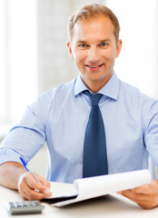 businessman with notebook and calculator