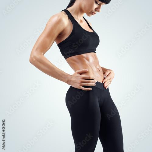 Zdjęcia na płótnie, fototapety, obrazy : Fitness sexy woman showing her well trained body
