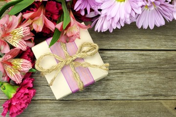 Rustic gift box with corner border of flowers on wood