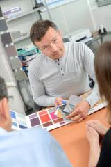 Designer advising couple on couple choices