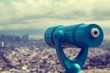 Blue telescope and blurred city on background. - 80804299