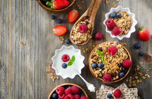 Fotobehang Aromatische Fresh healthy breakfast with granola and berries, copy space bac