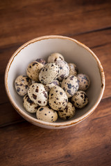 Quail eggs in a white colander, selective focus