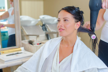 Drying a customer's hair