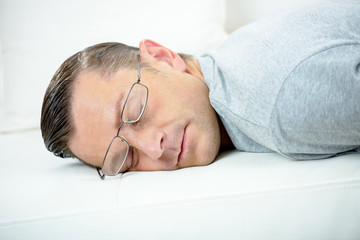 Man taking a little nap on the sofa