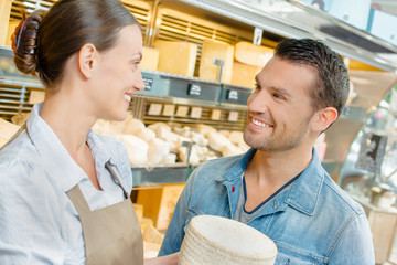 Woman advising a man about cheese
