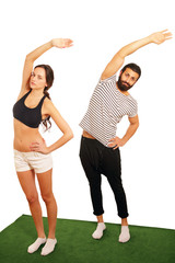 Couple practicing aerobics or stretching exercise