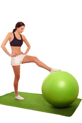 Cute girl exercising with gym ball