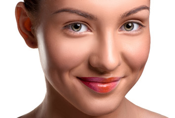 Closeup head shot of beautiful young woman with lips make up