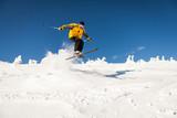 Man Snow Skiing Against Blue Sky