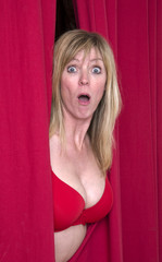 Woman with a shocked expression wearing a red bra