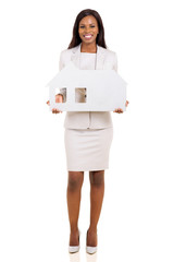 african business woman holding house symbol