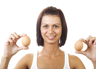 Young woman holding eggs