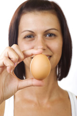 Young woman holding egg