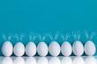 Leinwanddruck Bild - White eggs with Easter Bunny ears