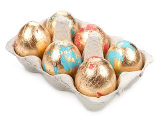 Gold easter egg isolated on white background