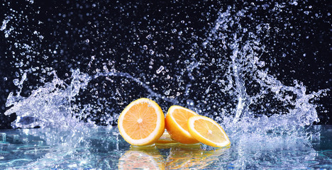 Macro water splash on lemon. Water drops with juicy lemon