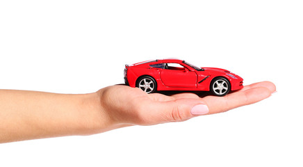 car in female hand isolated on white background