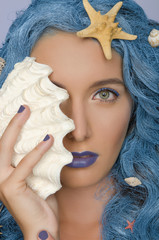 woman with blue hair, shells and open eyes