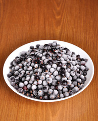 Frosted black currant in a plate