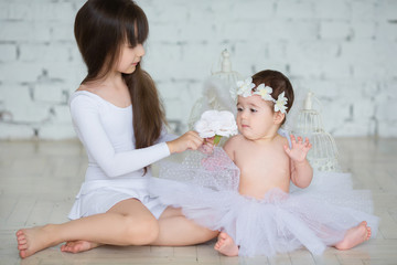 Two little girls in white dresses